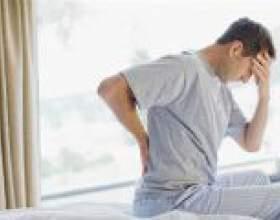 Чому болить спина після сну? фото